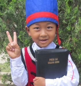 A Myanmar child holding the Bible.