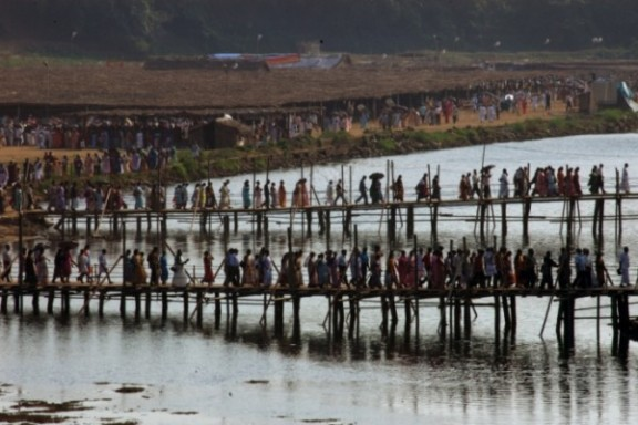 Temporary bridges built for people to cross the shallow waters of the River Pamba.