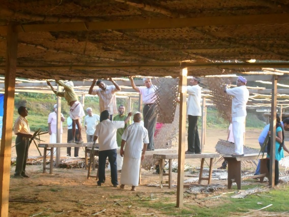 Parishioners help in setting up the roof of the Maramon convention Pandal using thatched coconut leaves. (Photo by  Sachin Jose - www.thewordswield.blogspot.ae)