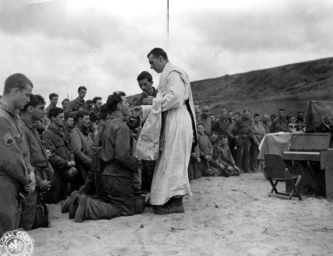 Father John McGovern gives mass in France during World War II. (U.S. Army Signal Corps)